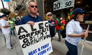A coalition of community, labor and environmental groups protest in Chicago, where the American Legislative Exchange Council (Alec) is holding its 40th annual meeting.