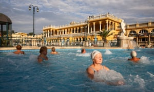 People soaking in thermal baths in Budapest, Hungary.