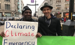 Larch Maxey campaigning with Caul Grant for Extinction Rebellion.