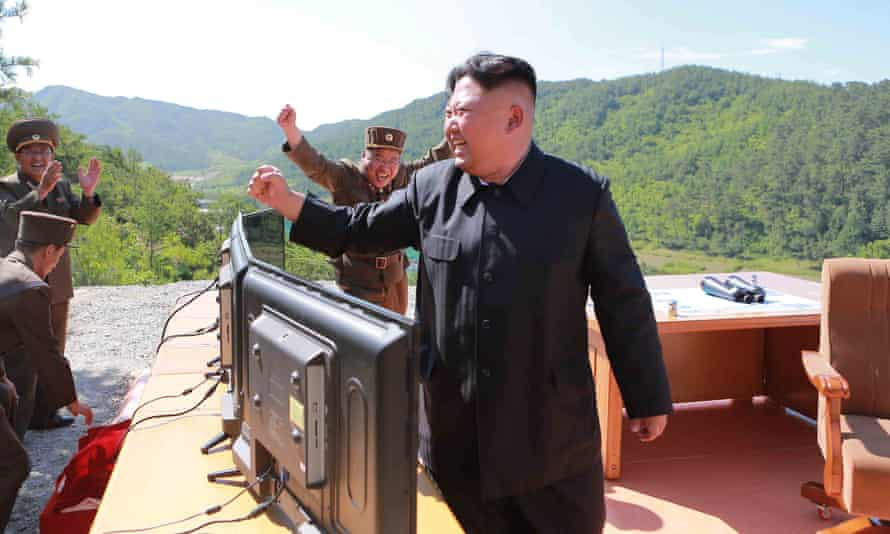 North Korean leader Kim Jong-un reacts during the test-fire of intercontinental ballistic missile.