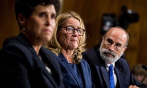 Christine Blasey Ford, center, flanked by attorneys Debra Katz, left, and Michael Bromwich, testifies during the Senate judiciary committee hearing on Thursday.
