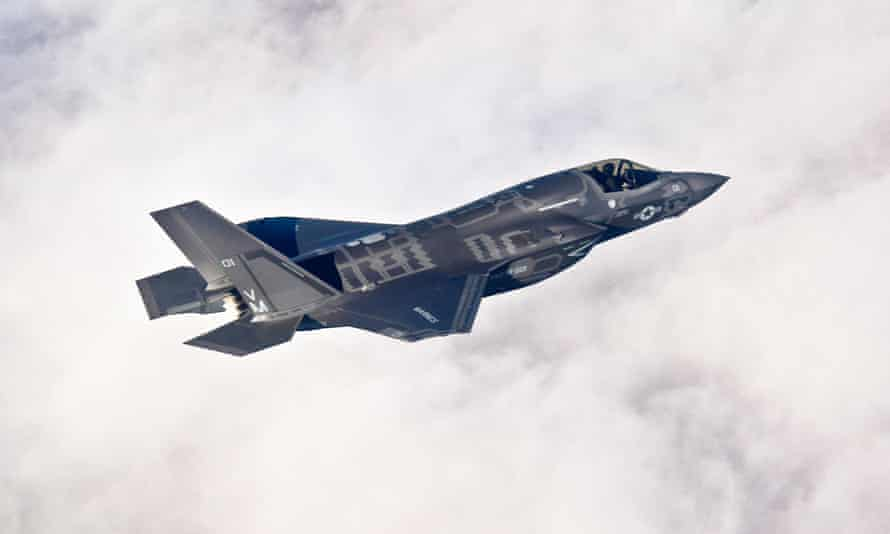 A Lockheed-Martin F-35B Lightning II fighter flies above an air force base in Florida. Trump says he has asked Boeing to 'price out' an alternative aircraft.