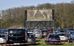 People watch a film at a new drive-in cinema in a field near Marl, Germany