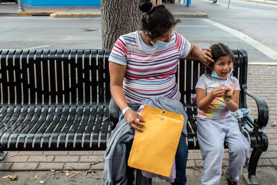 Alicia Barrios and her daughter Brittany sit on a bench outside the Catholic Charities respite center in McAllen, Texas.