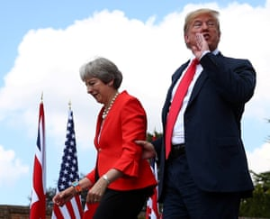 Theresa May and US President Donald Trump walk away after holding a joint news conference at Chequers near Aylesbury, 13 July.