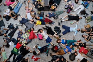 London, EnglandExtinction Rebellion climate change activists lie on the floor as they perform a mass 'die in' in the main hall of the Natural History Museum