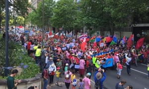 Sydney protesters march down Macquarie St in the people's climate march.