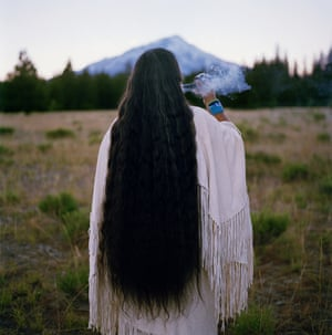 Chief Caleen Audrey Sisk Franco - the spiritual leader and last speaker of her tribe's language- sends smoke prayers toward Mount Shasta in California.