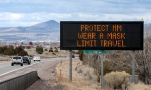 An information board along I-25 tells people some of the rules put in place by the emergency health order to help prevent the spread of Covid-19 in New Mexico, USA. The legislature is looking at scaling back some of the governor's emergency powers.