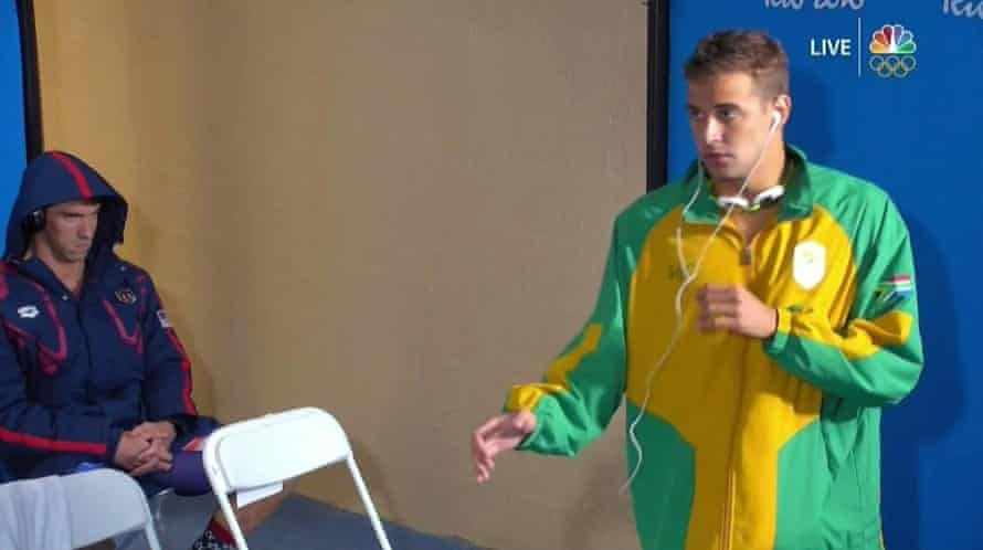Michael Phelps'sd death stare as Chad Le Clos warms up.