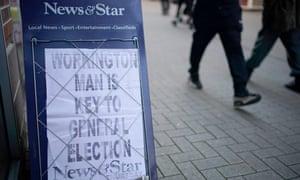 A newsagent's board in Workington, Cumbria