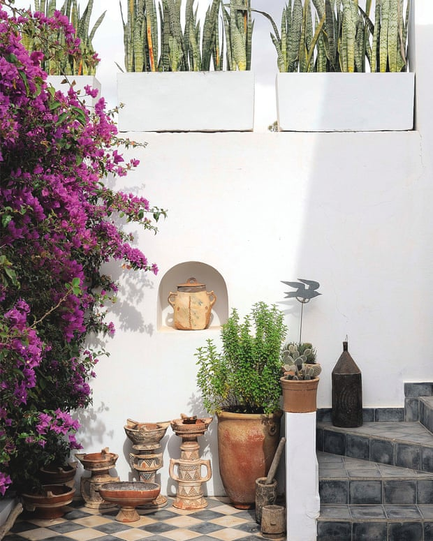 The outdoor areas act as rooms, with pots, seats and lanterns (find a wide range of furniture and lighting at moroccanbazaar.com).