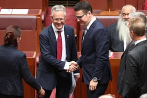 David Smith is congratulated by fellow ACT Senator Zed Seselja