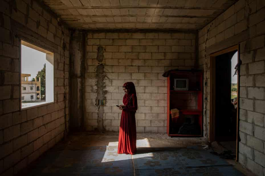 Abir, 17, a Syrian girl in the structure, still under construction, in El Kneisset in the Akkar area in northern Lebanon, where she lives with 14 other people