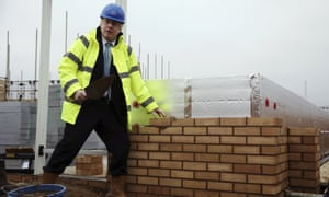 Boris Johnson laying a brick during a visit to the Barratt Homes - Willow Grove housing development in Bedford, England.