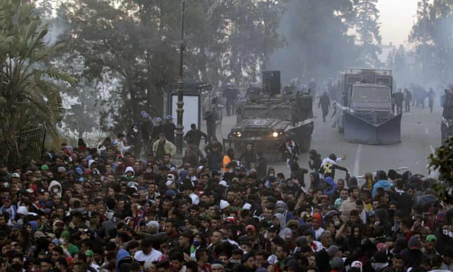 Protesters clash with police in the streets of Algiers on Friday.