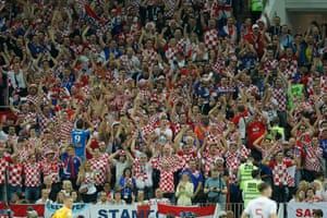 The Croatian fans celebrate.