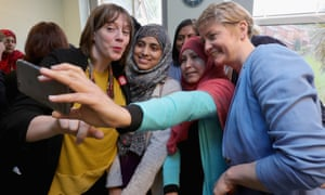 Yvette Cooper (right) and Jess Phillips (left) pose for a selfie with staff at Palfrey Sure Start Centre.