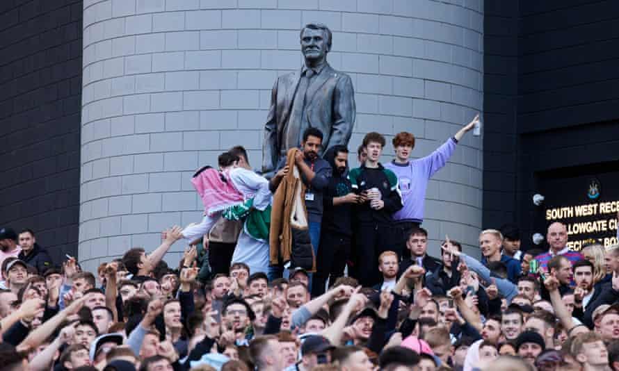 Newcastle fans celebrate the deal outside St James's Park.