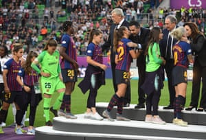 Barcelona's players receive their runners up medals.