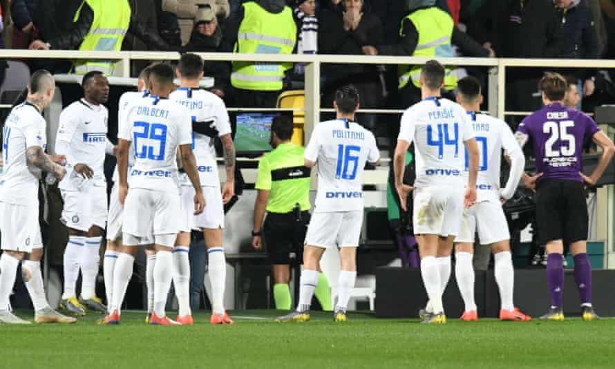 Referee Rosario Abisso checks the VAR during the 3-3 draw between Fiorentina and Inter.