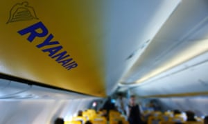 Passengers board a Ryanair plane
