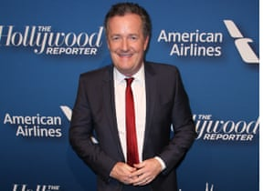 Piers Morgan at the opening of an envelope, yesterday.