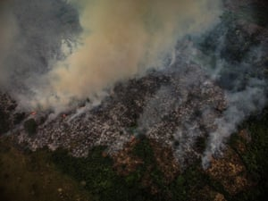 A picture taken with a drone shows a clearance fire set by local farmers in the province of Kwilu. Clearance of natural bush and forest is a factor threatening DRC's unique wildlife