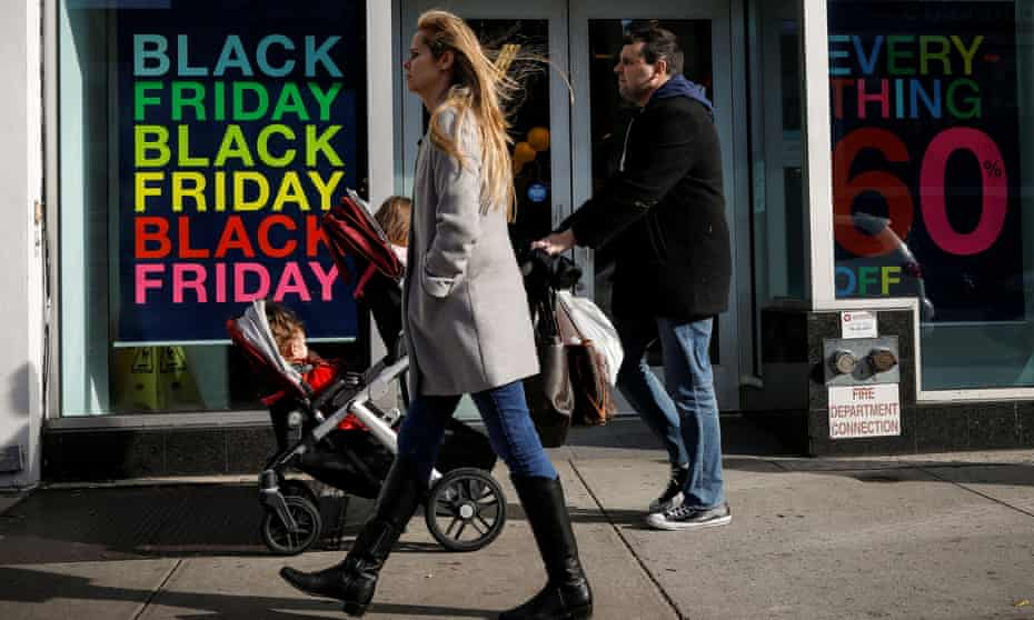 Holiday shoppers take part in Black Friday sales in Brooklyn, New York, on 29 November.