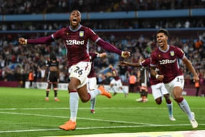 Jonathan Kodjia of Aston Villa celebrates with team mate Andre Green after scoring his team's second goal