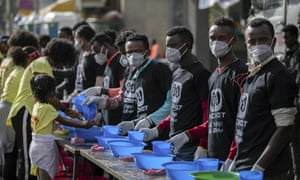 Volunteers in Ethiopia at soap and water stations at a fun run in the capital Addis Ababa. Global coronavirus deaths and infections have outstripped those inside China for the first time.