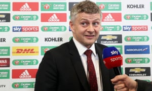 Manchester United coach Ole Gunnar Solskjaer is interviewed in front of the Carabao Cup table.