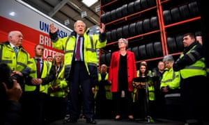 Boris Johnson talking to workers at Fergusons Transport in the town of Washington, west of Sunderland, with Gisela Stuart, the former Labour MP and former Vote Leave chair, and CEO Alan Ferguson (left).