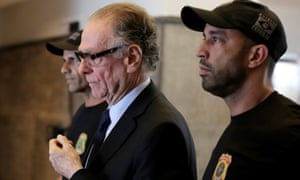 Brazilian Olympic Committee president Carlos Nuzman is escorted from the federal police headquarters in Rio de Janeiro.