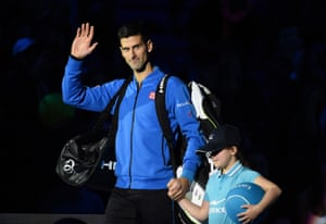 Djokovic makes his entrance with a mascot.