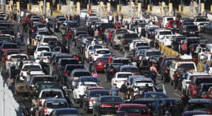 People attempting to cross into the US at the closed San Ysidro port of entry at the US-Mexico border on Sunday.