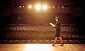 Woman walking across stage