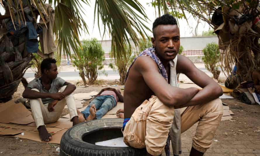 A young African migrant rests in a park frequented by Ethiopians in the port city of Aden