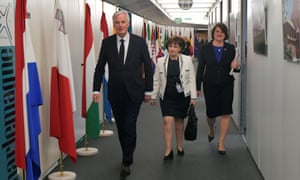 The EU's chief Brexit negotiator, Michel Barnier, with DUP leader Arlene Foster (right) and DUP member Diane Dodds.