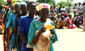 People line up for food distributions near the town of Aweil in Northern Bahr el Ghazal