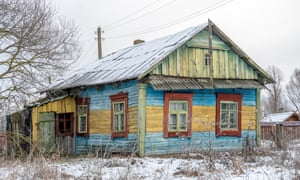A colourfully decorated log home in Kudrychy village near the town of Pinsk in Brest region. The village is located on the fringe of the Middle Pripyat Reserve.