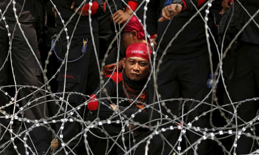 An Indonesian trade union supporter attends a protest in Jakarta over job cuts and wages.
