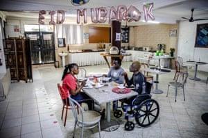 Asiya Mohammed has breakfast with athlete Miriam Nandwa and Team Kenya's physiotherapist Josephine Kaburu.