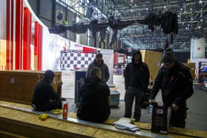 Workers stop preparations of the 90th Geneva International Motor Show, GIMS, at Palexpo, in Geneva, Switzerland, Friday, Feb. 28, 2020..