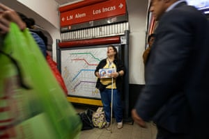 Mariana, 43, standing in subway with a white stick