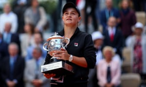 Ashleigh Barty holds the Suzanne Lenglen trophy after her surprise victory at Roland Garros, the Australian's first grand slam title.