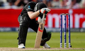 New Zealand's James Neesham reacts after losing his wicket.