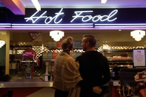 A couple waits in line for hot food at the diner candy bar