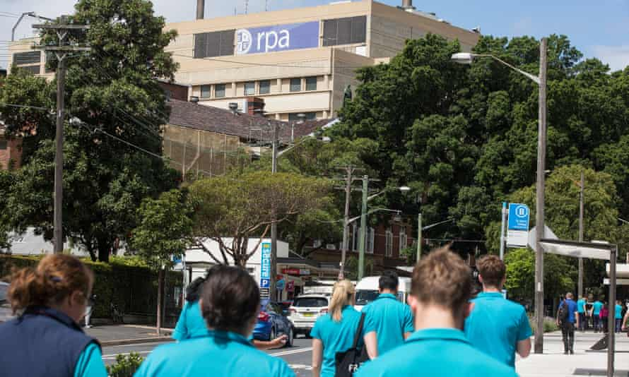 Staff from Royal Prince Alfred hospital walk to work