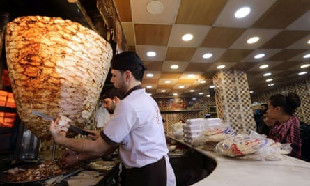 Shawarma being prepared in Damascus. The Syrian government has imposed a 'reconstruction tax' on the sandwiches.